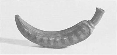 Pottery whistle modeled in the shape of a pod of the pacay tree (Inga pacay). This is from the Mochica culture of the North Coast of Peru, dating from about A.D. 200. Length 9 ½ inches.