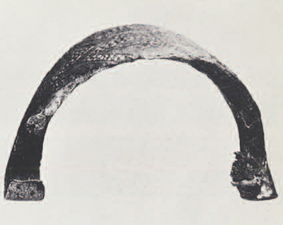 Bronze fibula of the 7th—6th century B.C. bought in Armenia, eastern Urartu of Trans-Caucasus region. Note the lack of a spring and the remains of the pin tied around the arc. Length, 4.5 cm.