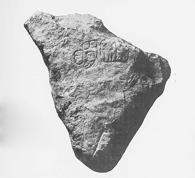 "Fig. 8, Miscellaneous Sculptured Stone 21, Piedras Negras. From collapsed exterior masonry of palace Structure J-9, Acropolis Court2. Note incised hieroglyphs and straight ""doodle"" lines. Excavated 1935. Stone measures 10 x 16 x 10 cm. (ca. 4 x 6 ¼ x 4 inches. ""Double-handed"" glyph measures 5 x 4 cm. (ca. 2 x 1 1/2 inches)."