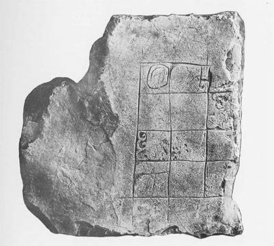 Fig. 6. Miscellaneous Sculptured Stone 3, Piedras Negras. Used as top stone, carved side up, in secondary masonry step-platform of palace Structure J-12, Acropolis Court 2. Note incised grid, incomplete carvings in non-contiguous squares. Excavated 1931. Maxium dimensions of sculptured surface, 45 x 46 cm. (ca. 18x 18 inches); stone is 7 cm. thick (ca. 3 inches).