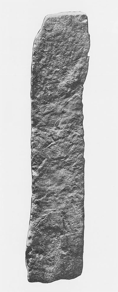"Fig.5. Surface 3 of MSS-8: photograph. Incised features are ""doodle"" lines, faint grid lines and incomplete realistic human profile face. Surface measures 48 x 10 cm. (ca. 19 x 4 inches)."