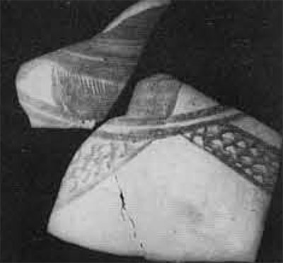 Painted motif on potsherds, perhaps representing a multi-oared boat.