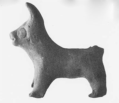 An animal figurine of the crude handmade variety typical of the Late period at Mohenjo-daro.