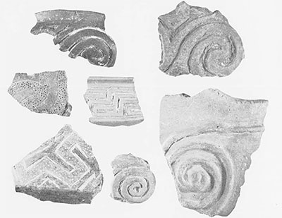 Decorated potsherds typical of the Bronze Age Apennine Culture; from the acropolis.