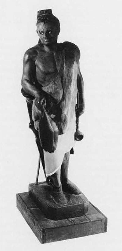 Small Indian. Lent by Mrs. E. Florens Rivinus, Height 34 inches. Typical of the age when snuff taking and pipe smoking were fashionable is this small Indian with the long pipe in one hand and the sheaf of tobacco leaves in the other. Unless it is a copy of an earlier model, it is probably pre-1840 although, later, when Indians were made life-size or larger, there was a dealer in New York who specialized in little Indians about thirty inches high.