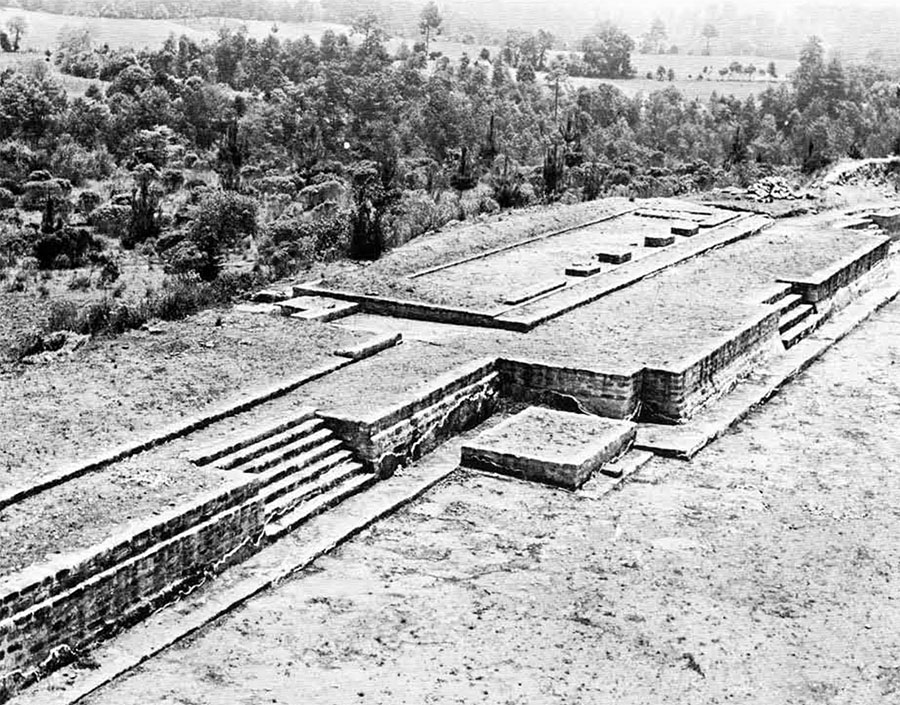 Structure 23 in foreground, with 22 beyond, both palaces on the north side of Plaza A.