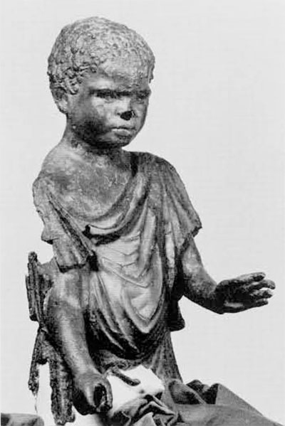 The same statue, after being cleaned, reveals the figure of a Negro youth. Now in the Bodrum Museum, the statue was on exhibit in the university Museum during the loan exhibit of Turkish Art Treasures.