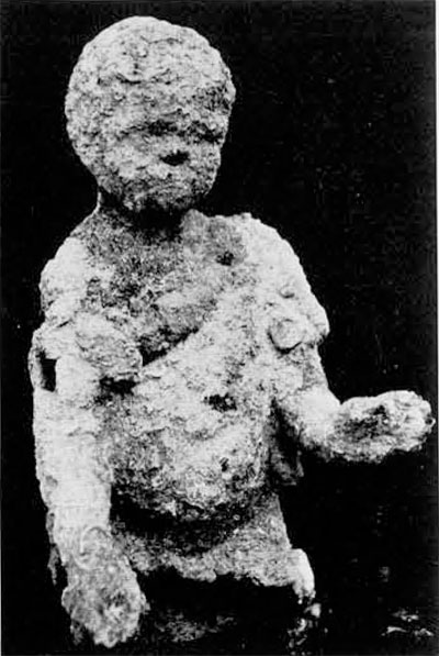 Bronze statue, still covered with concretion, as it was pulled from the sea in 1963. This find offered the first clue to a possible shipwreck lying near Pascha harbor in 300 feet of water.