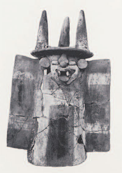 Late Preclassic pottery incense burner with modeled face of a bat (god?) recovered from a ceremonial cache within the ramp of Mound 1.