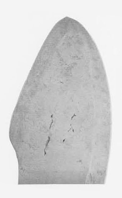 The tip of a copper-bladed snow knife from the Eskimo of Victoria Land. This tool was used to cut a layer of hard-trodden snow into rectangular building blocks for the construction of a snow igloo. The blade itself had been cut to a slab by stone-sawing and was then ground and polished flat. Its edges were then hollow-forged by cold-hammering, and finally edged by honing, The blade shows open voids carried over without distortion from the piece of natural copper; some of those shown form natural perforations through the blade of the knife. The copper shows crystal structure in delicate tones of gray.  Museum Object Number: NA 4072