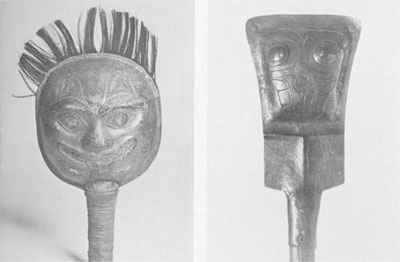 (Left) Mask-shaped rattle of native copper representing the bear. The faces, which are identical, were shaped within a hollowed wooden form with a minimum of forging and were finished by carving and grinding. The edges are joined by many copper rivets. The hair is human hair squeezed between the two halves of the rattle during the riveting. Height, l2 inches.  Museum of the American Indian, Heye Foundation No. 23/5600.  (Right) Shield-shaped Tlingit rattle of native copper representing a miniature lina or 'chiefs copper.' All of the detail is carved into the thick copper slab.Phoebe A. Hearst Museum of Anthropology No. 2-4805.