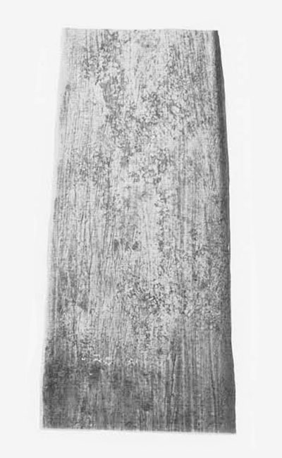 Longitudinal stone-saw marks on the reveres (flat) face of a Tlingit dagger blade of native copper. This photo has been made on ortho process film for maximum contrast in the topography of the cut surface; details of the cut and of crystal structure are thus exaggerated by photographic distortion.  Museum Object Number: 42-30-42.