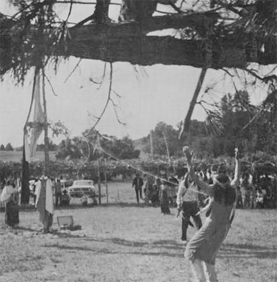Petaga Wakanhas broken free from one of the lines and is pulling upon the second, his arms raised in prayer. Third day.