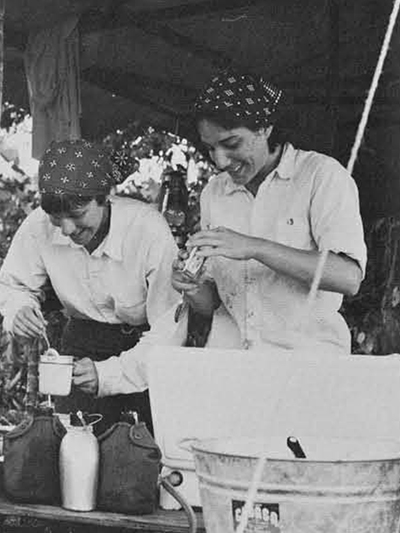 Irene Borgogno and Eleanor Jane Rosenthal cooking at the camp site.