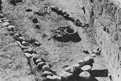 Foundation stones of a structure dating from the sixth millennium at Chogha Sefid, excavaed in 1968-69. These stones are adjacent to a platform of dense yellow clay bricks that cap a core of soft gray mud bricks, also of the sixth millennium.