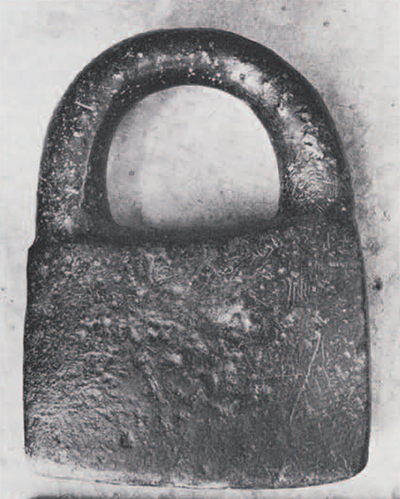Steatite padlock-shaped object (about 2700 B.C.) reused in modern shrine. Originally a weight? Height, ca. 30 cm.