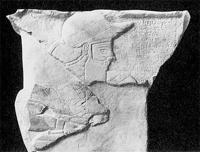 Fig. 3. Fragment of a limestone stela of Adda-Hamiti-Inshushinak, about B.C. Height, 32.7 cm. In the Musée du Louvre.