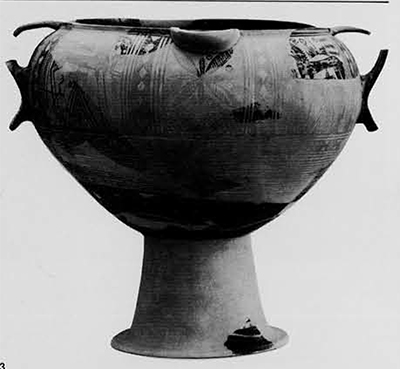 Local Geometric krater: The lighter parts are restored in plaster, but the back (with simpler decoration) is preserved. Most of it was found on the floor of Structure I, but other pieces had been scattered about the excvations by later disturbances. The height of the foot is uncertain and has been restored in accordance with certain vases from the necropolis.