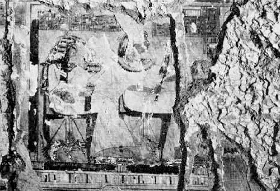 Damaged part of the wall in the tomb of the Forth Prophet of Amun, Raya (no. 159 at Dira Abu el Naga), with a panel depicting a seated couple, scored for removal by modern antiquities thieves but abandoned when the plaster chipped over the head of the man. Much of the decoration of this tomb has been removed of destroyed in this way.