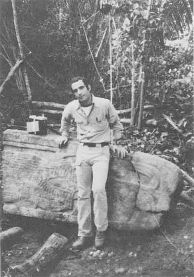 The author, Robert Reinhold, standing before stela at remote Guatemalan site of Naranjo, where looters have stolen almost all sculpture.