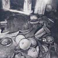 Collapsed tables in the King's Tomb, and bronze bowl.