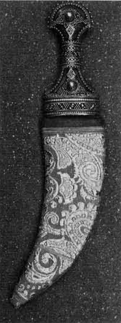 A Hoeida dagger in modern sheath of gaudy fake brocade, very popular in the Tihama District.
