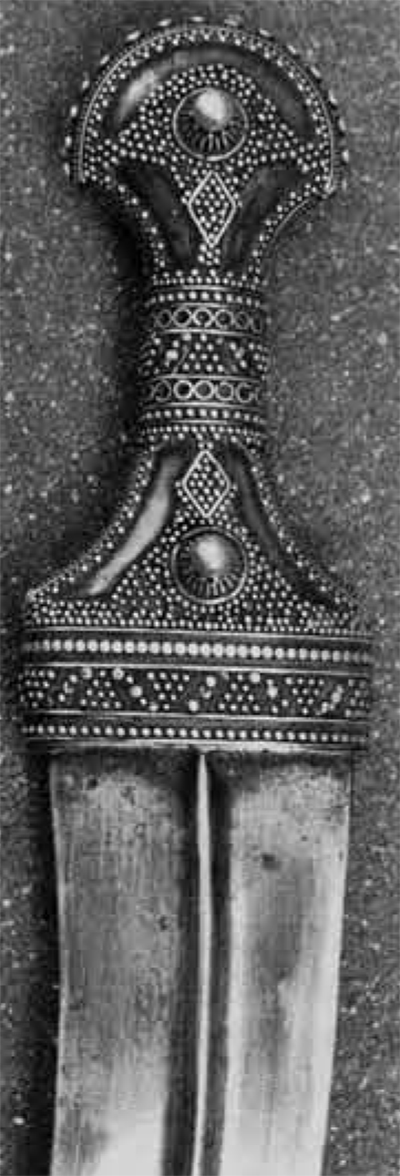 A silver-hilted dagger, Hodeida style.
