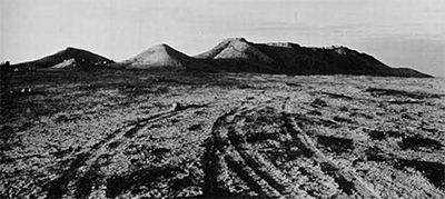"""General view of the """"Solitary Hill of the Wells.""""Kuntillet 'Ajrud is located on the furthest peak to the right."""