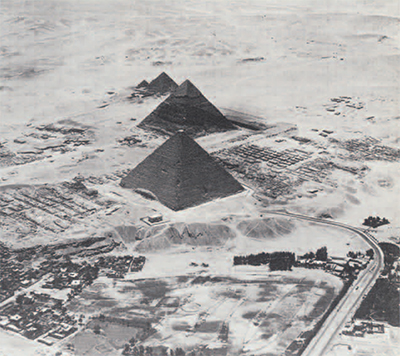 The pyramids of Giza from the northeast. The Great Pyramid is in he foreground with mastabas of the western cemetery laid out in rows to the right and the mastabas of the eastern cemetery on the slope to the left. The Pennsylvania-Yale Expedition has been working in both areas in four summer seasons