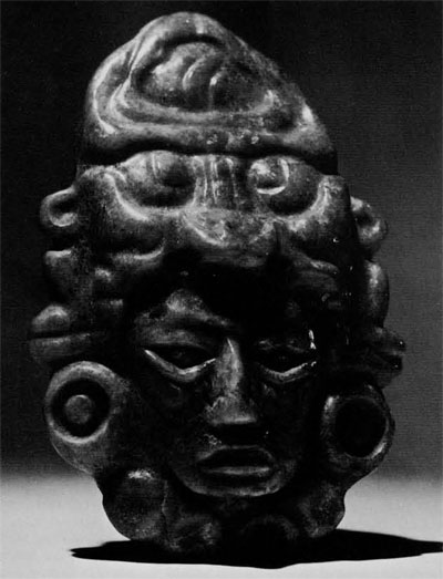 Pendant from tomb in structure 5D-11, WEst Plaza, Tikal Late Classic Period