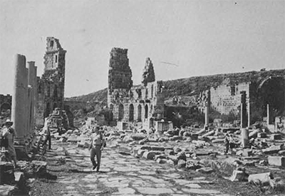 Since groups are limited in size, membes have the luxury of unhurried, uncrowded hours amid ancient ruins. Here, the members of the 1964 tour to Turkey pause for picture taking in the ruined streets of ancient Perge. Photo by Kenneth D. Matthews.