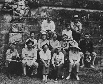 At the Maya site of Copan in Honduras, Dr. Alfred Kidder II, second from left, relaxes with an adventurous band of travelers. This 1962 trip to Copan and Tikal was the first tour arranged by the Women's Committee.