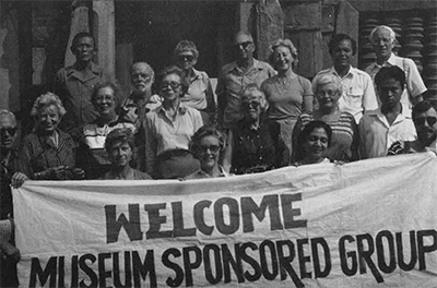 In 1982 the tour planned by the Women's Committee went to the archaeological sites of Thailand. The group was led by William Schauffler of the University Musuem, bottom right, and included two members of the Women's Committee: Mrs. Pierre Fraley, bottom row, second from left, and Mrs. Alvin Gutman, top row, third from right.