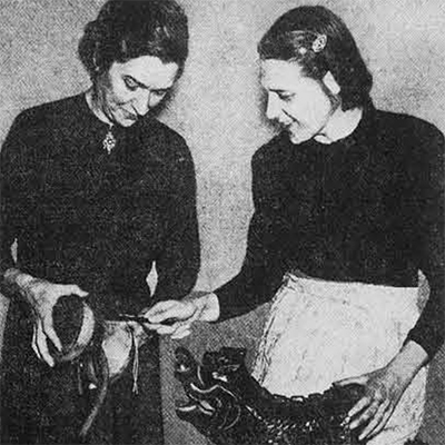 The Women's Committee has been involved in almost every aspect of the Museum's work. In this 1950 photograph, Mrs. Nancy Lamont and Mrs. Francis Pell, Jr. go over some of the musical instruments being prepared for the exhibition 4000 Years of Music.