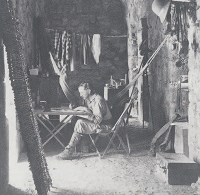 "Alfred Maudslay in a photograph from A Glimpse at Guatemala entitled ""My room — Chichên Itzá, 1889."""