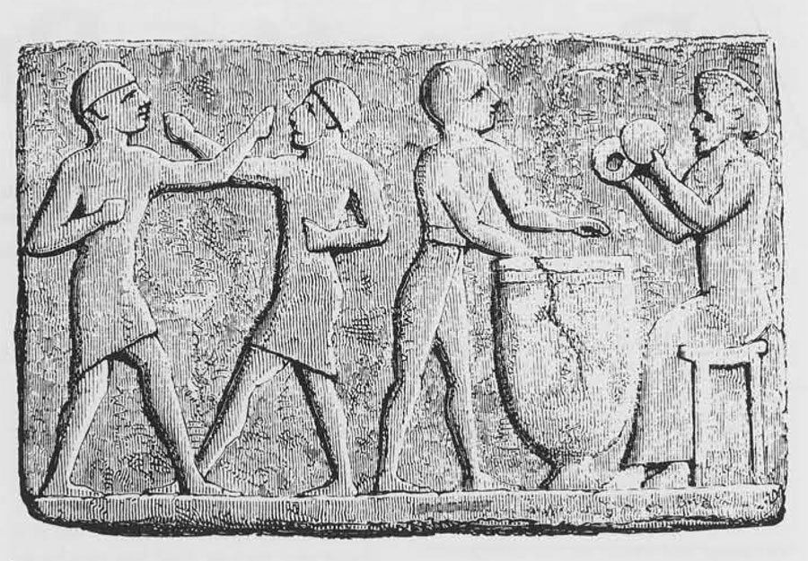 Two men box (?) while two others play drum and cymbals on this clay tablet from a tomb at Sinkara (Larsa in southern Iraq.)