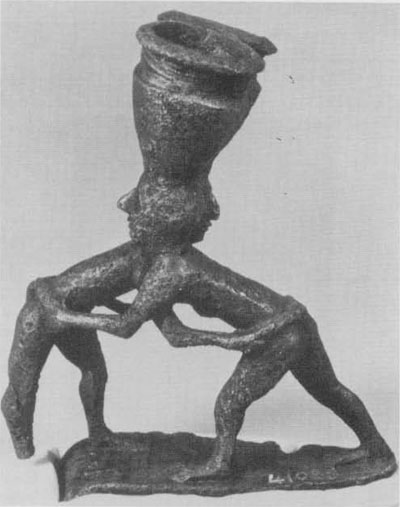 Statuette from Khafaji, Iraq, showing two wrestlers grasping easch other's girdles; ca 2600 B.C.E.