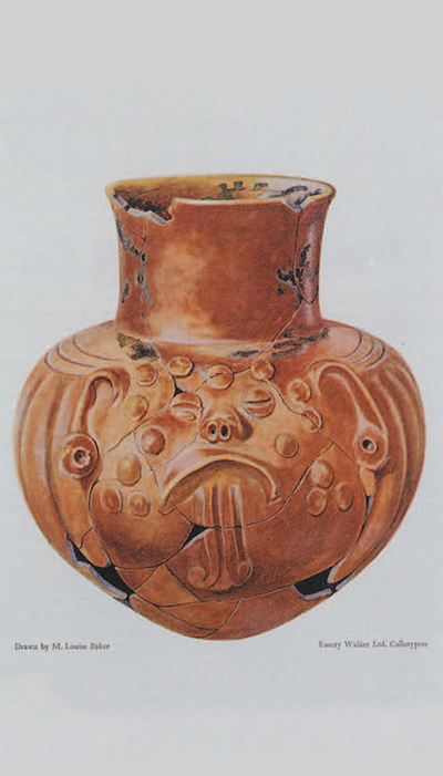 Bulb-shaped vase with neck, of polished red clay; the relief decoration represents an animal face. Copan, Honduras. H. ca. 16.5 cm. Pl. XII by Mary Louise Baker from Maya Pottery.