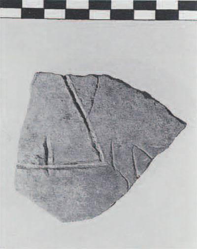 Late Bronze Age vessel from Gordion, found in a stratum deposited in the 4th century B.C. The broad grooved lines that form the triabngle indicate that this mark was applied to the vessel before firing. The thin-lined Phrygian letters were scratched on the surface hundreds of years later. (Roller 1987a:pl.1:1A-4)