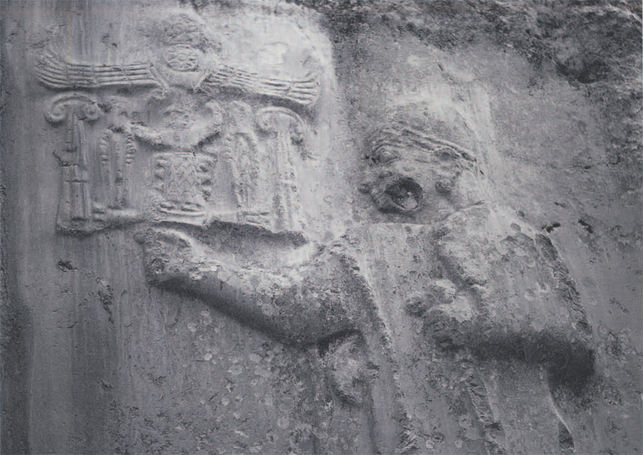 Relief of King Tuthaliyah within the rock shrine of Yazilikaya at Bogazkoy, Turkey. The relief is approximately contemporary with the Later Bronze Age settlement at Gordion. In the upper lefthand corner is the king's name written in the hierglyphic script employed at the Hittite capital H. of relief 2.95m. (Phot courtesy of M.M. Voight.)