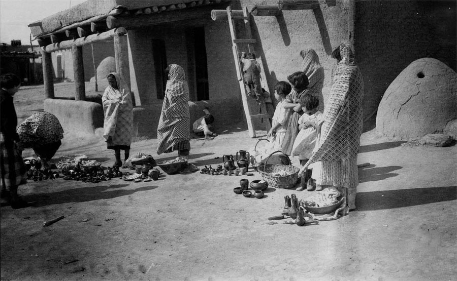 Pottery vendors at Santa Clara Pueblo, ca. 1935.  Courtesy Museum of New Mexico, neg. no. 4145. Photo by T. Harmon Parkhurst.