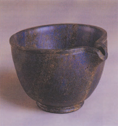 Through-Spouted Cup of Lapis Lazuli. While th eroyal tombs yielded dozens of gold, silver, and calcite vessels, this small lapis lazuli cup is unique in shape and material. Lapis lazuli, more often used for small objects such as beads and plaques, probably came from far-off Afghanistan.  Penn Museum Object Number: B17167