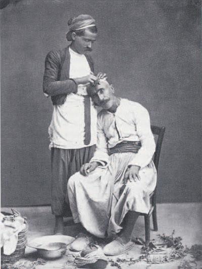 """""""Barbier rasant son client"""" (Barber shaving customer). Albumen orint by Bonfils, before 1885"""