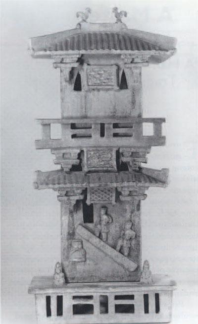 Fig 3. This model of a granary includes human figures carrying sacks of grain, and roosters on the roof. Han Dynasty. Courtesy of Glascow Museums: The Burrell Collection.