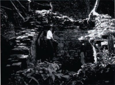 Throne room structure J-11, Piedras Negras, Guatemala. Tatiana Proskouriakoff and Sixto Laines taking measurements. 1936 UPM neg. S5-17235