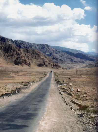 A road in Northern India in the Ladakh Region, mountains in the distance.