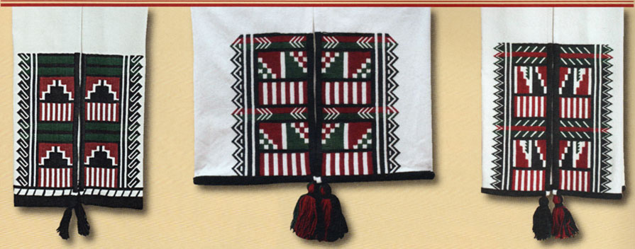 "These Towa dance kilts, or kei-té, were made by Isabel Gonzales. According to her, Pueblo people ""wear traditional attire when we have traditional dances. We pray for good rain, for harvest, and for a good life and to give us good blessings in our homes, for health and for strength and guidance in our lives. Dance kilts are used for many different purposes. They are worn by men in corn dances and by ladies when they do the buffalo dance. Usually the designs interpret the rain, clouds, and in the left example, mountains. In my work I try to interpret the best way I can with our traditional life . . . . This middle kilt is similar to the first one, but the designs are a little bit different. The arrows are pointing to the center as the drum group meets at the center of the plaza. The step designs are like the dance headdresses, or tablitas, that the women wear. Tablitas are a prayer for rain, and I consider these here as prayers for rain as well."" Isabel's embroidery includes a number of meaningful details. For example, close examination of the last kei-té (right) reveals that the top edge of the black embroidered zigzag mountain design is embroidered to suggest that it continues—her ""ongoing prayer for continuation and continued abundance in this life."""
