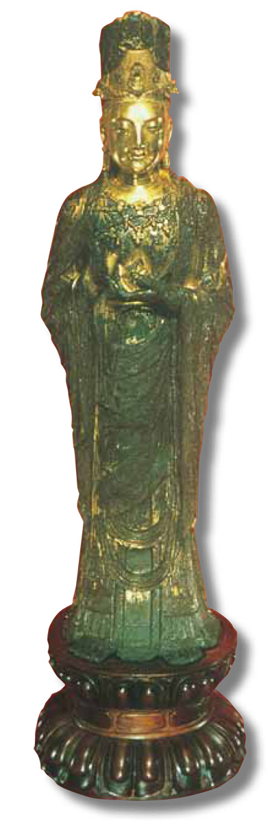 The gilt bronze statue  of Guanyin holds a lotus  bud in its left hand.  It measures 71 cm in  height. UPM #C400.