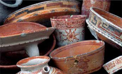Painted vessels of various shapes were discovered in structures 14 and 15.