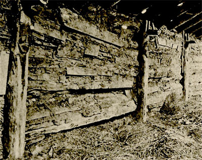 Fig.35-Interior of the Ceremonial Lodge, showing posts with carved faces to represent the Messengers of Gicelamukaong.